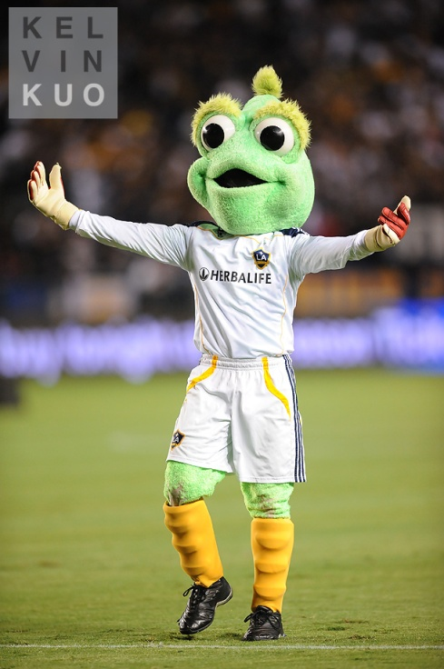 "The Los Angeles Galaxy is apparently a ""soccer"" team.  Their mascot is this alien (who also shills herbal supplements)."