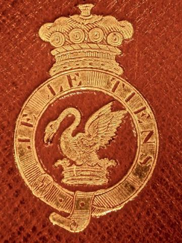 The Coat of Arms of Baron Audley (featuring a mean swan and a coronet)