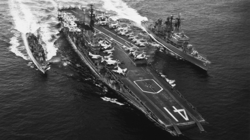 Carrier USS Midway (CVA 41) is flanked by destroyer USS Picking (DD 685) on the left, and guided missile destroyer USS Preble (DLG 15) (from the US Navy Museum website)