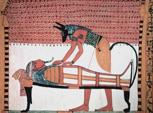 Anubis attending the mummy of the deceased (tomb mural from the tomb of Sennedjem, ca. 1300 BC).