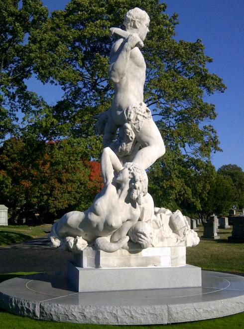 A side view of the statue shows the nude allegorical figure of vice (or maybe corruption)