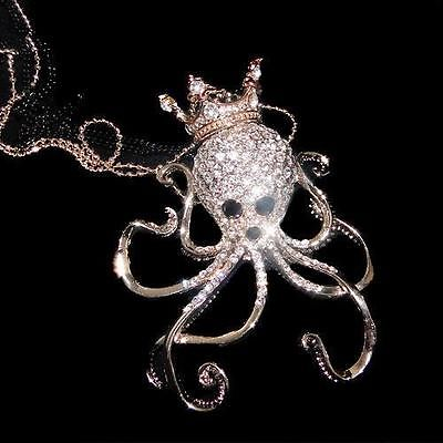 A rhinestone octopus wearing a crown (jewelry pendant)