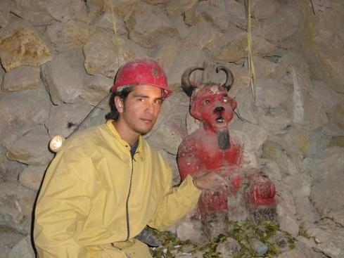 A Peruvian Miner with A Supay Votive Statue