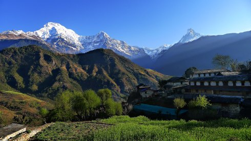 The high Himalayas  seen above the village of Ghandruk, Nepal (photo from http://holeintheclouds.net)