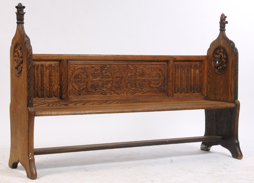 Carved American Gothic style oak bench circa 1910