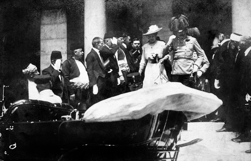 Archduke Franz Ferdinand and his wife get in their car in Serbia five minutes before they are both shot