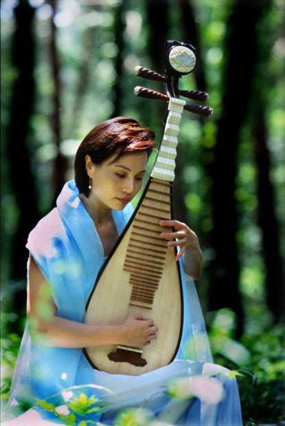 A woman holding a pipa (Chinese lute)