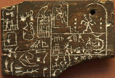 Ebony label depicting the pharaoh Den, found in his tomb in Abydos, circa 3000 BC