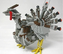 A turkey crafted from legos, chocolate, and silverware