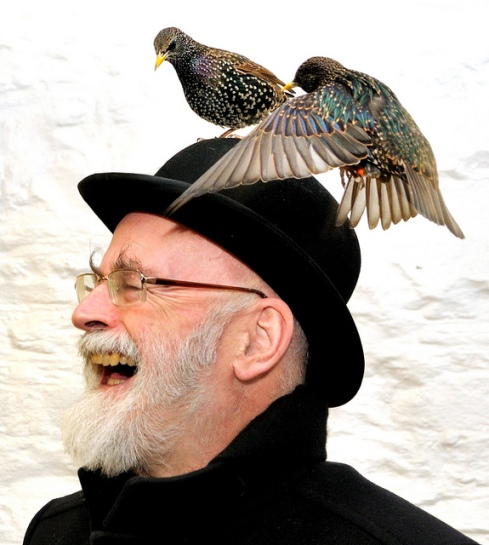 Terry Pratchett with Starlings on his Head