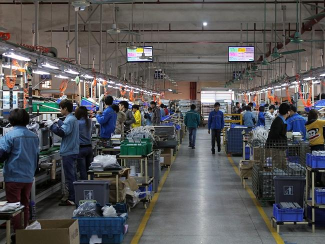 Workers at a Microwave Factory in Baotao China