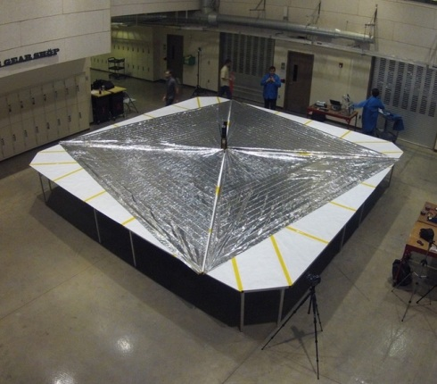 The Planetary Society's LightSail spacecraft, with its four sails deployed, undergoing tests in Sept. 2014. Credit: Justin Foley/The Planetary Society.