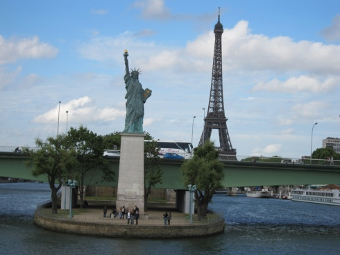 A quarter scale model of the Statue of Liber...Liberty Enlightens the World in Paris France--it's even on a miniature island.