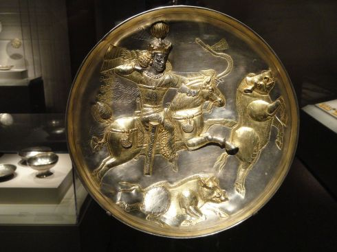 Silver plate with Shapur II hunting boars )ca. 4th century, silver with gold leaf)