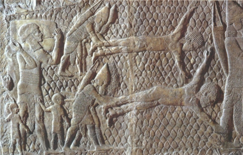 Bas relief from the palace of King Sennacherib: Assyrian soldiers flay the captives of the conquered city of Lachish in 701 BC.