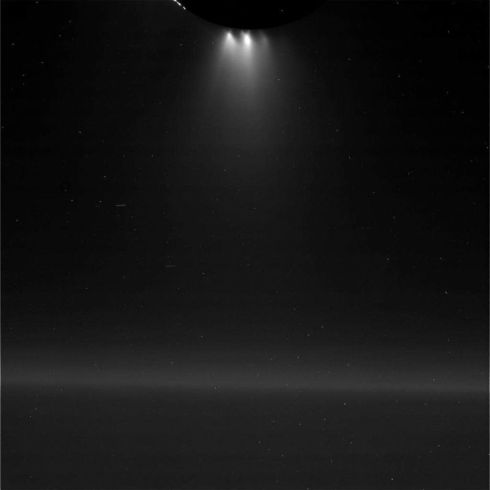 View of Enceladus' south pole geyser, backlit by Saturn