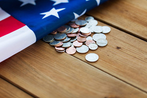 graphicstock-budget-finance-money-crisis-and-nationalism-concept-close-up-of-american-flag-and-cent-coins_SWGjO6QTBb_thumb.jpg